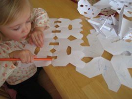 lucy coloring snowflakes