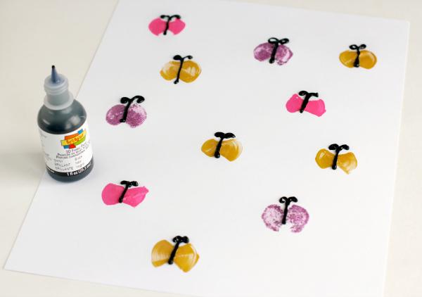 Adding Black Puffy Paint to Foam Brush Butterflies