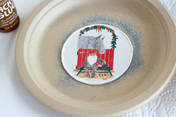 Adding Glue to Vintage Coasters Turned Glitter Ornaments