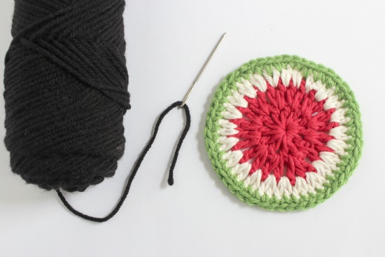 Adding black yarn for watermelon seeds