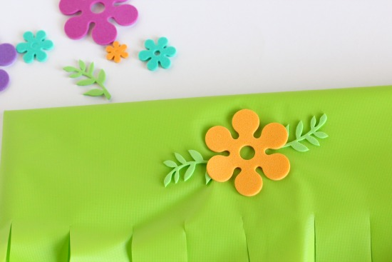 Adding flower stickers to hula skirts