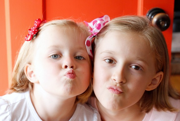 Cute Sisters with Hair Bows