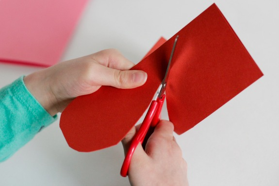 Cutting Paper Hearts @makeandtakes.com