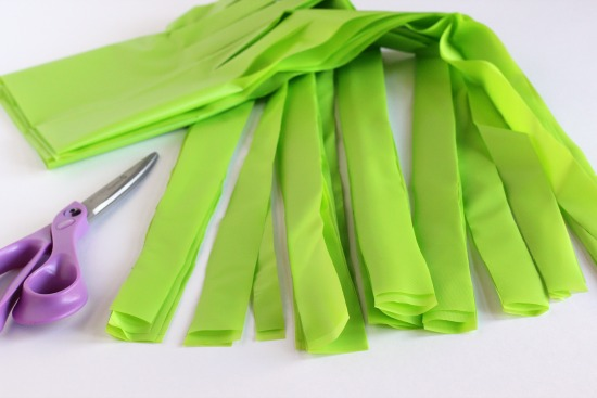 Cutting handmade hula skirts for birthday party