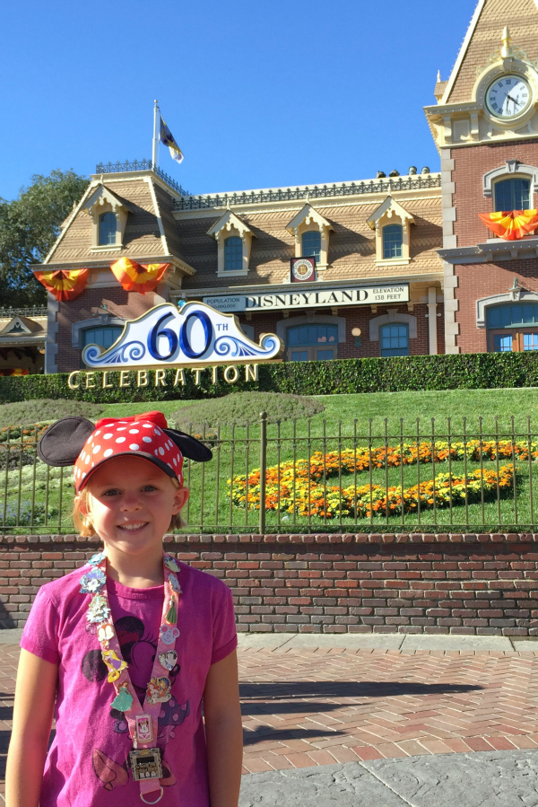 Decked out Disneyland with Disney outfits and Disney pins
