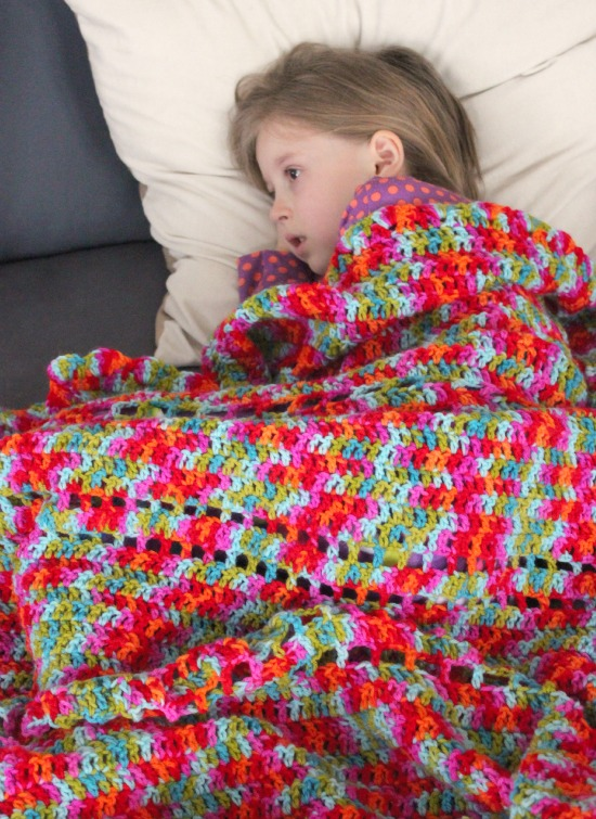 Kids Cuddling in Crochet Afghans