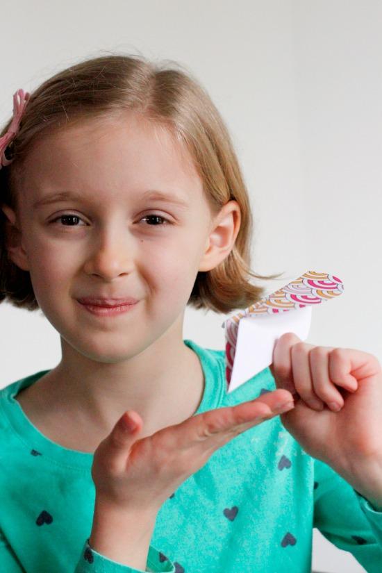 Kids Making Valentine Heart Airplanes @makeandtakes.com