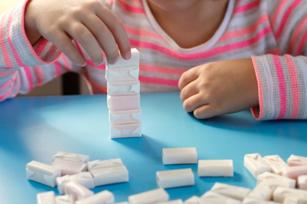 Kids Play Stack em' Up Game with Candy