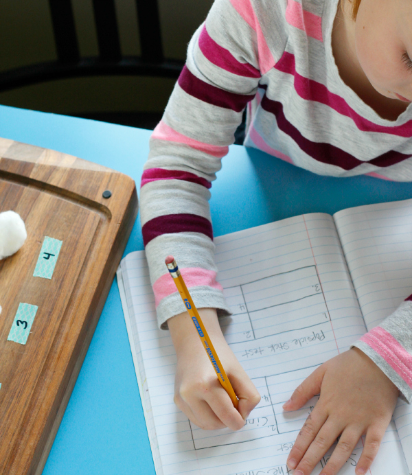 Kids Writing Findings in a Science Journal
