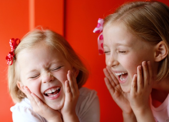 Laughing Girls wearing hair bows