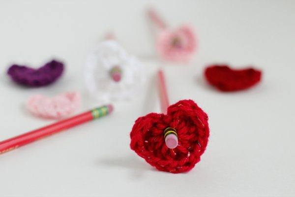 Make Crochet Heart Pencil Toppers via yarnfix.com