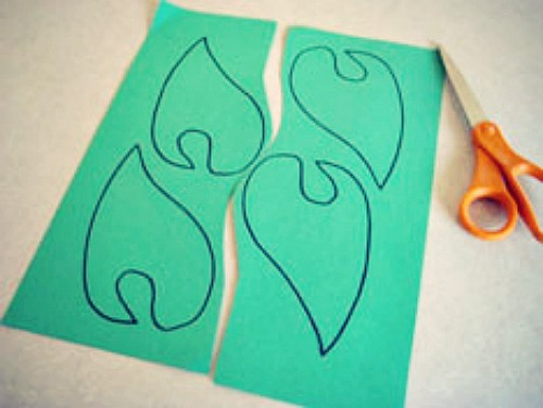 To make these ears, draw the same shape onto green paper and cut them ...