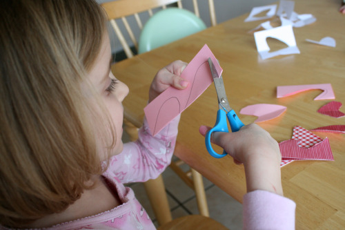 Practice cutting with toddler scissors