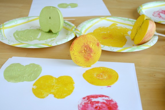 Stamping Apples in Paint for a fun Apple Print