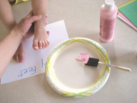 Stamping Feet in Paint