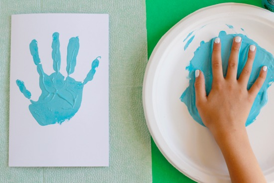 Stamping Kids Painted Hands