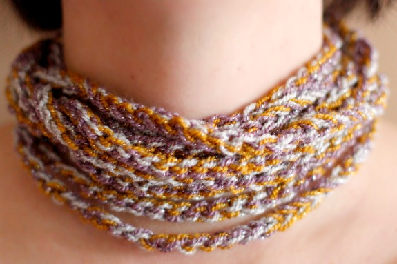 Wearing a Crochet Chain Stitch Necklace @makeandtakes.com #crochetaday