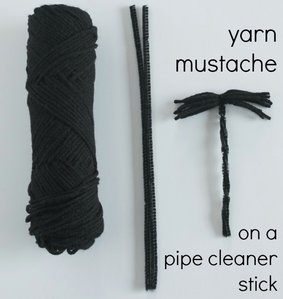 Yarn Mustaches on a stick