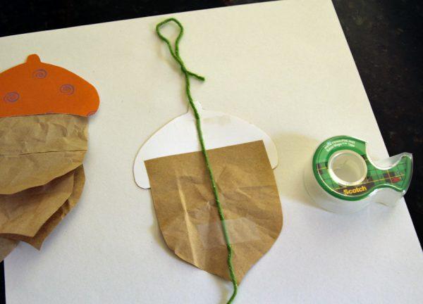 Paper and yarn acorn garland