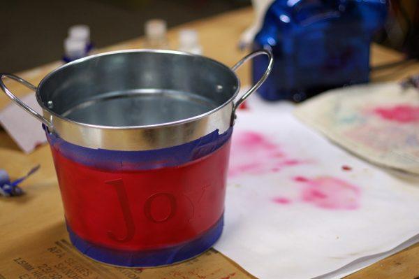 Joy stenciled bucket
