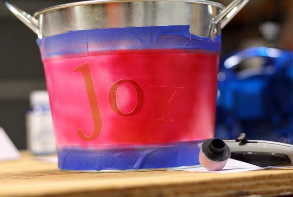 Airbrushing metal bucket with letter stickers