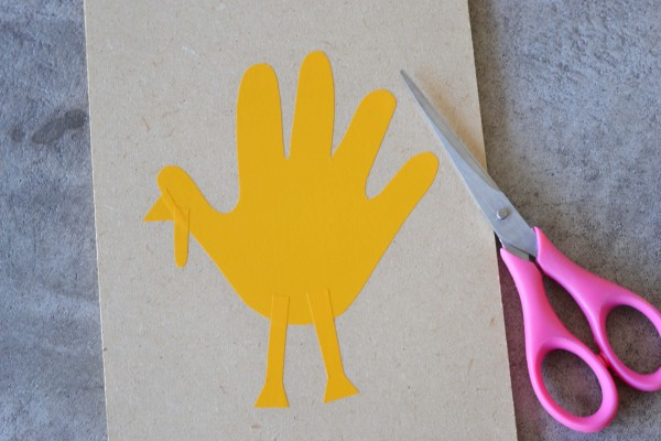 cutting and glueing handprint