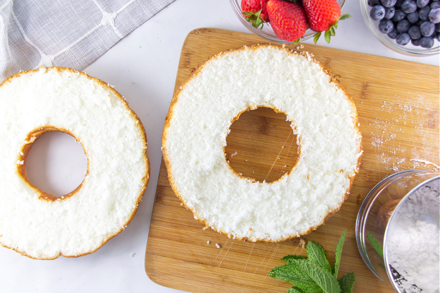 angel food cake sliced in half to fill with whipped cream and berries