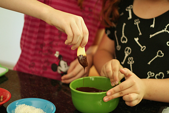 Dipping apple slices in chocolate