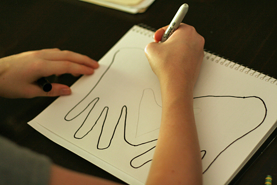 Tracing hands in art journal