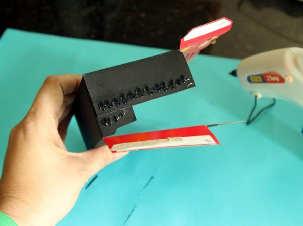 Assembling a cardboard play camera