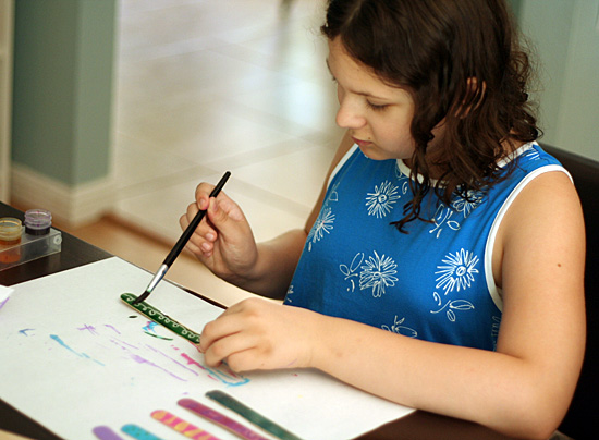 Oil pastels and watercolors on craft sticks
