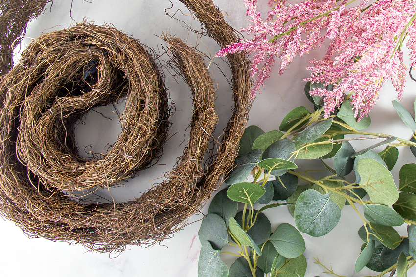 vine wreath, eucalyptus leaves and pink flowers to make a wreath