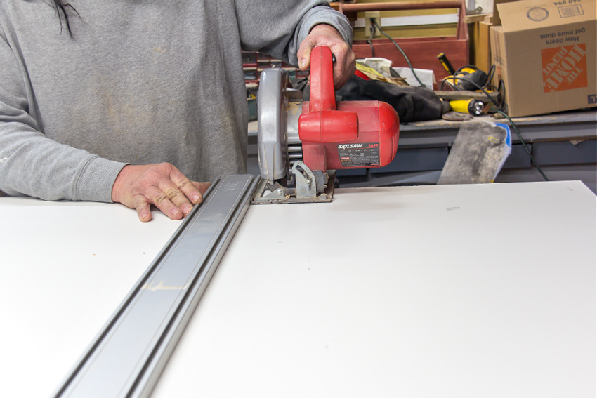 coated plywood being cut with a saw to make a box