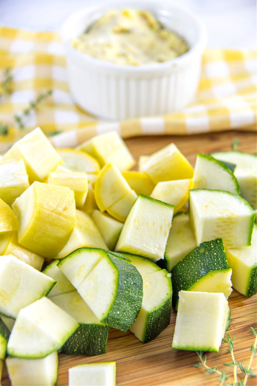 Diced zucchini and yellow squash on a cutting board