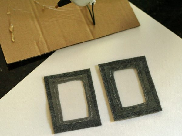 Plastic window and felt frame