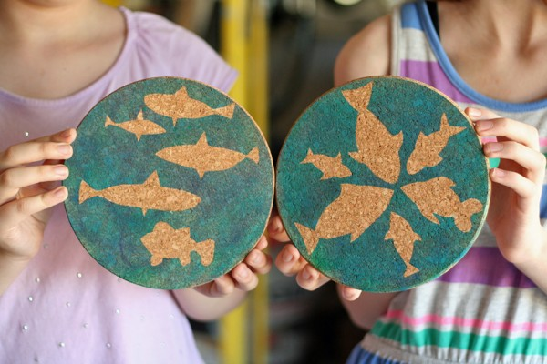 Jumbo coasters with airbrushed fish silhouettes
