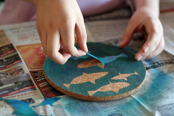 Fish stickers and airbrush painted coasters