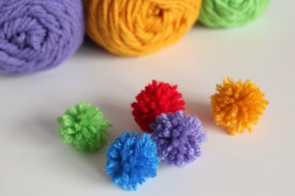 Mini Yarn Pom Poms makeandtakes.com
