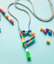 This DIY Pipe Cleaner Monogram Pendant Necklace makes the cutest favors for a birthday party. Fun and Colorful, it's sure to be a big hit with kids!
