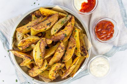 homemade seasoned potato wedges with condiments