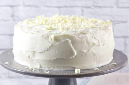 white cake on a grey cake stand