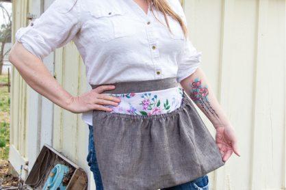 a lady wearing a handmade harvest gathering waist apron