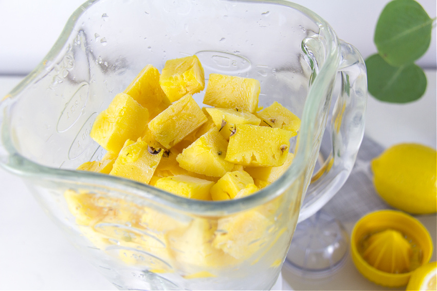 frozen pineapple chunks and ice in a blender