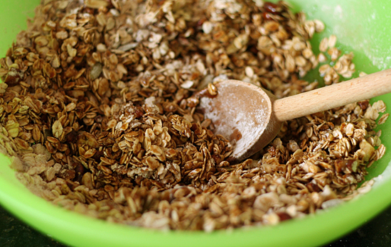 Mixing Gingerbread Granola Recipe @makeandtakes.com