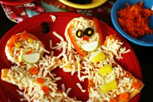 Gingerbread boy and girl veggie pizzas