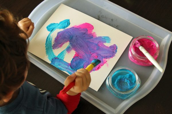 Painting and color-mixing with tempera and glitter