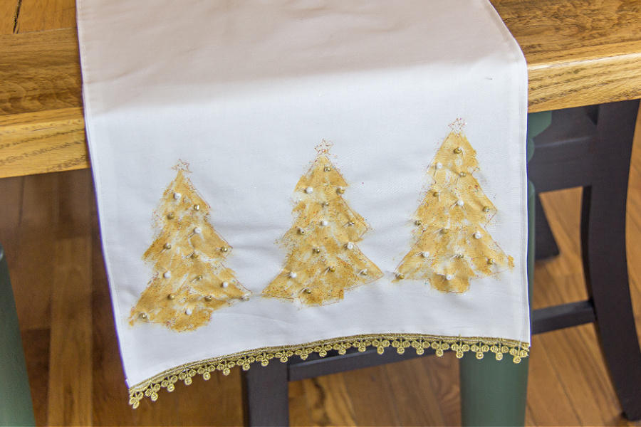 White table runner with hand-painted gold christmas trees and beads