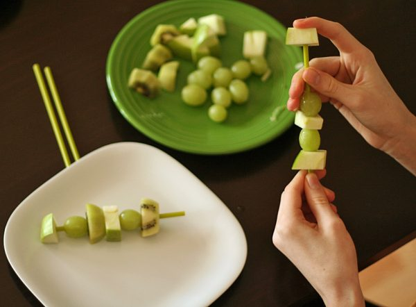 Making green fruit skewers with kids