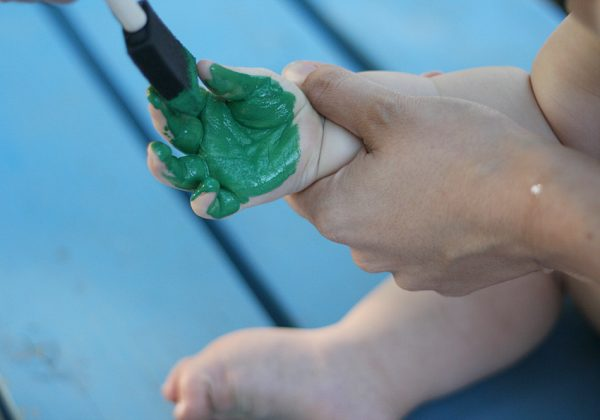 Making a handprint with a baby