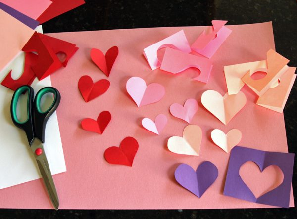 Cutting paper hearts for Valentine cards